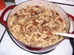 How To Clean an Enameled Cast Iron Dutch Oven - picture of chili being cooked in red Dutch oven
